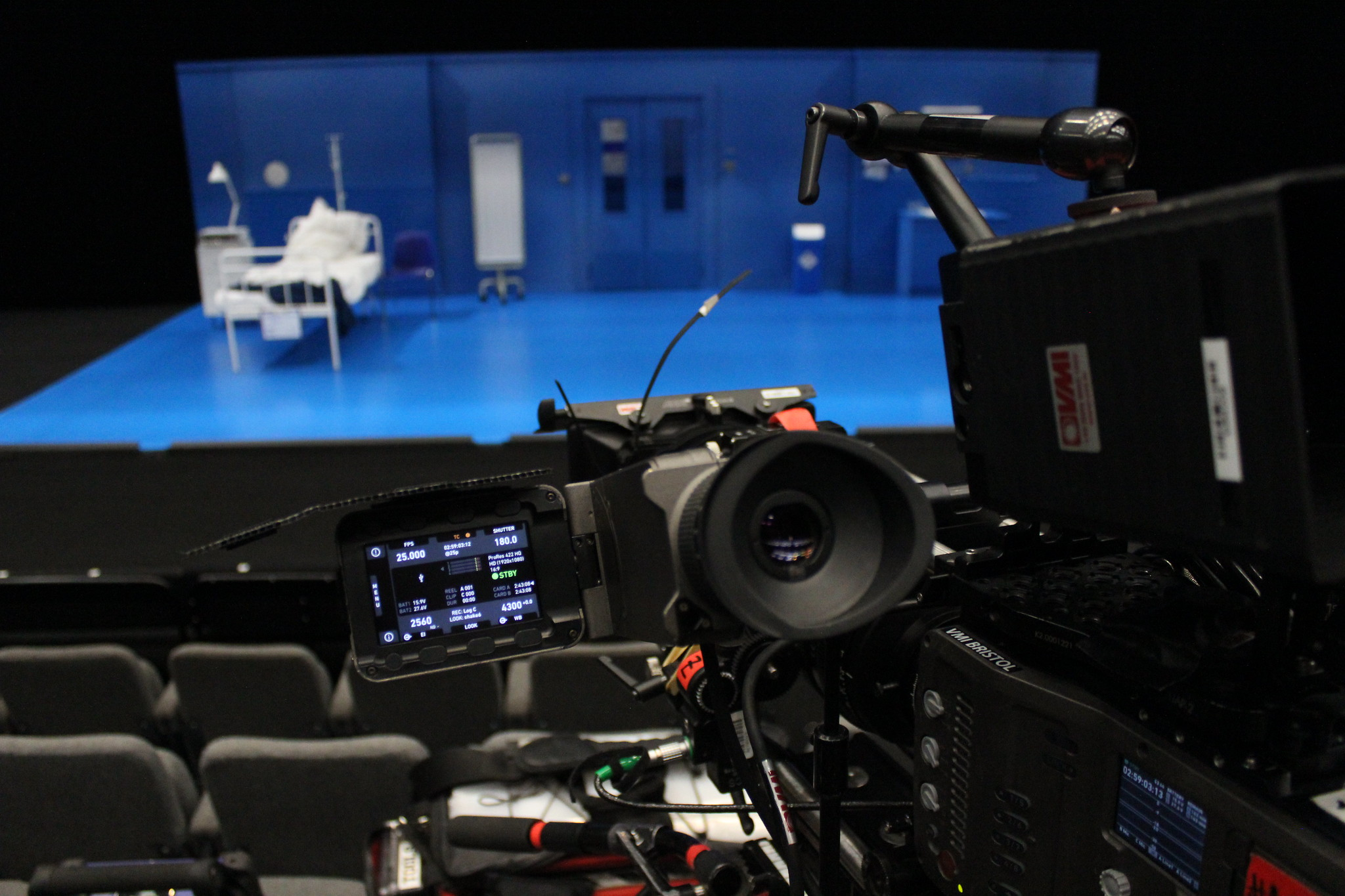 Close up of video camera filming a theatre stage