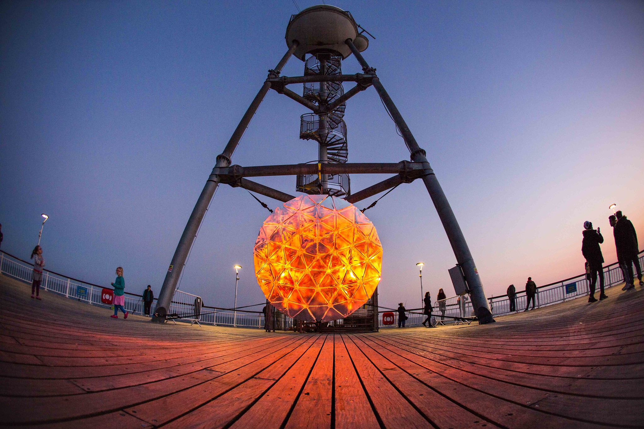 Image of a 'rising sun' art installation on sea front