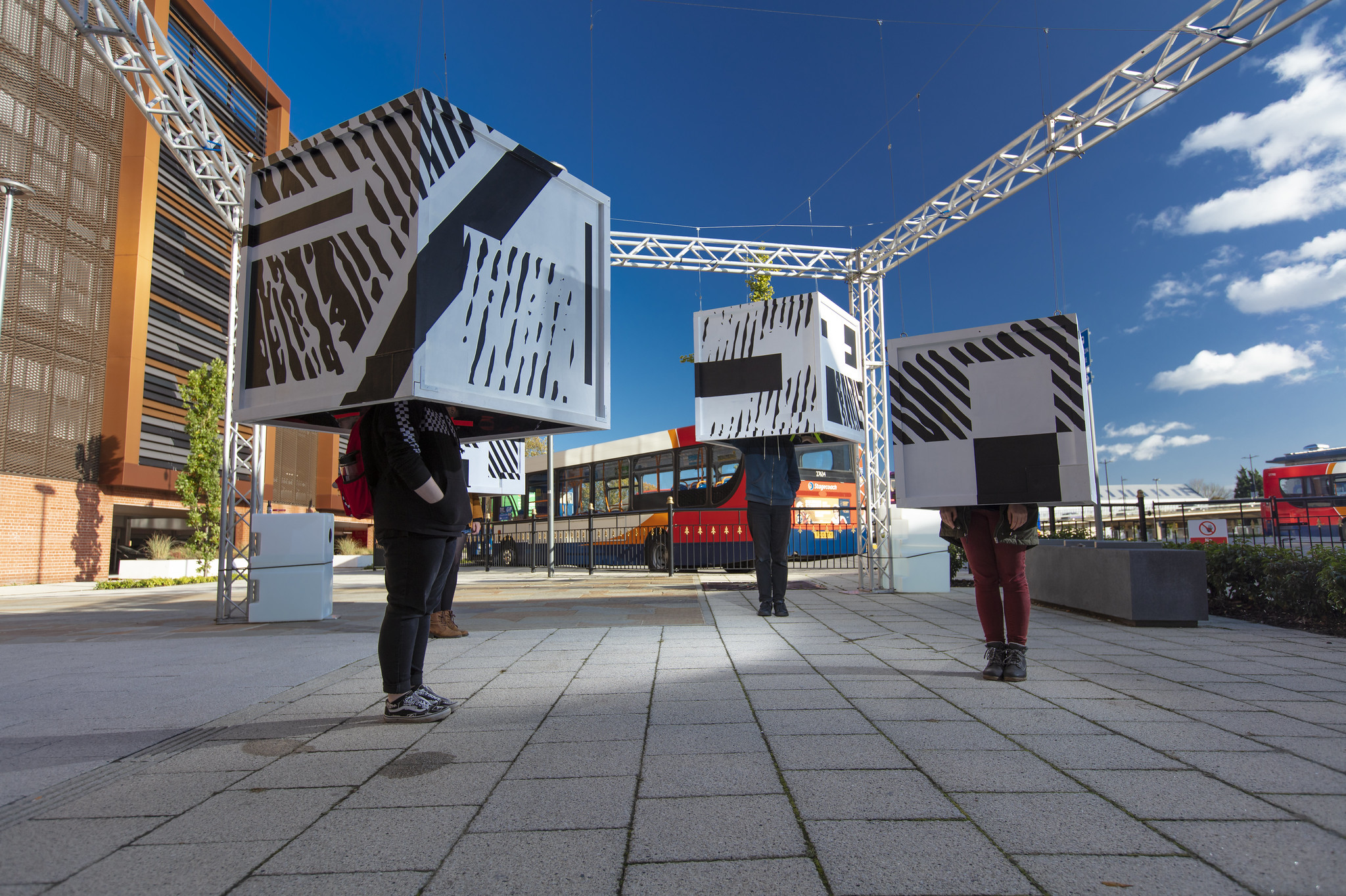 Urban artwork, people with boxes on heads