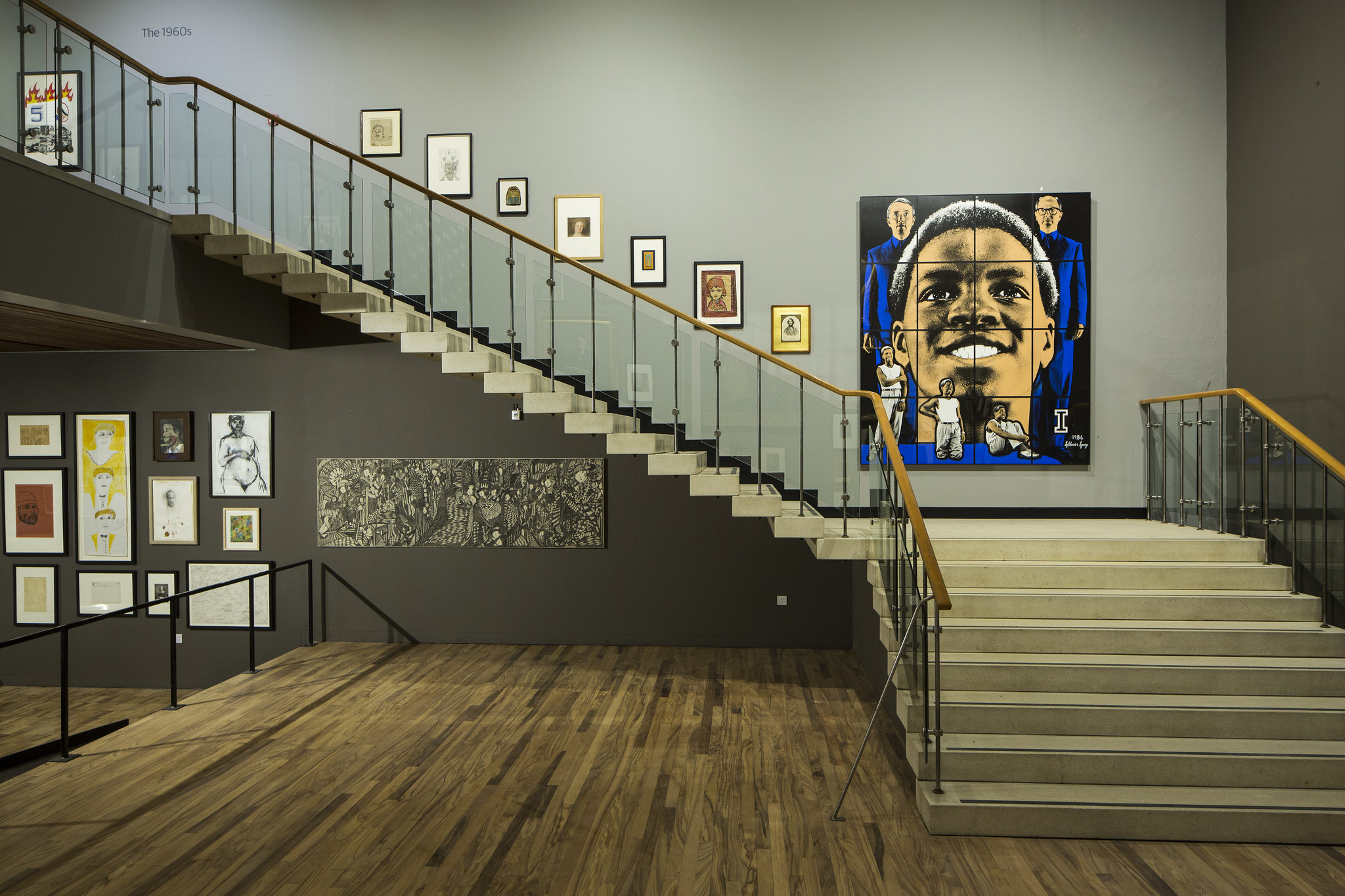 Portraits around a staircase at the Whitworth Art Gallery