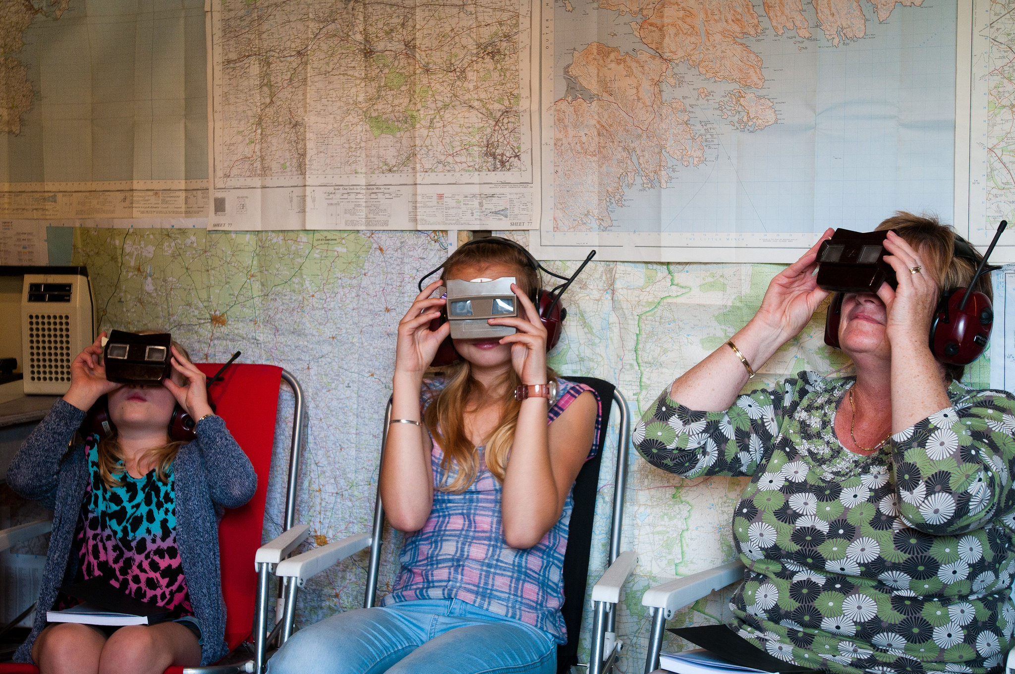 Three people wearing VR headsets
